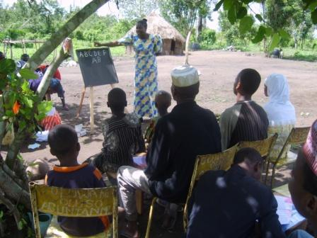 Moji giving literacy classes to herdsmen