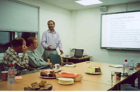 Shamprasad Pujar presents to colleagues at the Institute of Development Studies