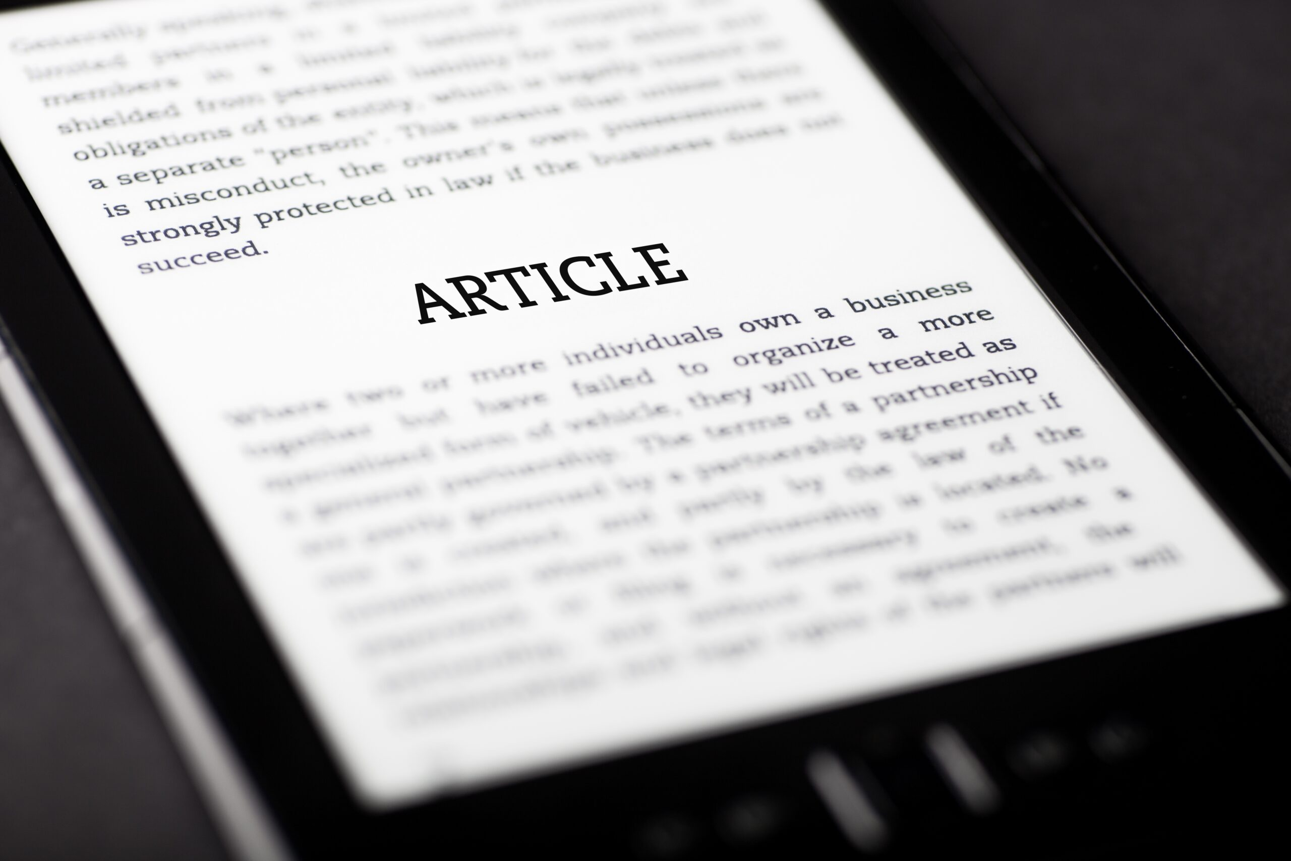The word article is on a tablet