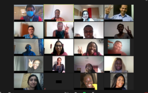 Video conference screen showing event participants smiling and waving
