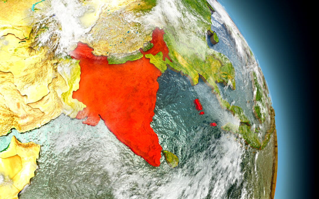 3D model of the Earth showing India in red surrounded by cloud formations