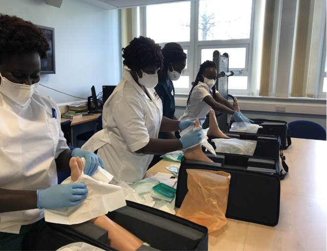 The Fellows working on their foot dummies inside a clinic room