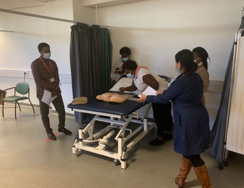 The Fellows attending to a dummy model in a clinic in Salford