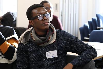 Commonwealth Scholars sitting in a development workshop.