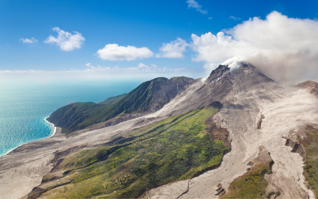 View of Soufriere Hills Volcano with sea in background.